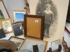 A quantity of photo frames.