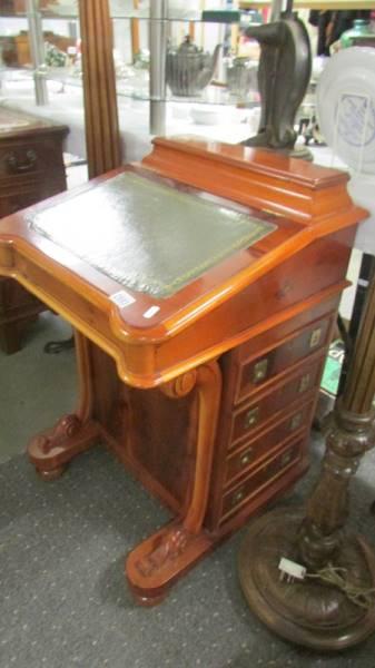A reproduction mahogany Davenport.