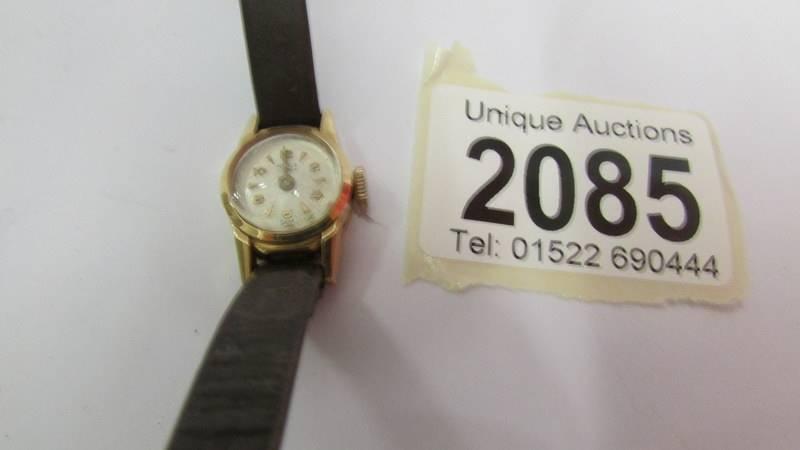 An 18ct gold ladies wrist watch (not working).