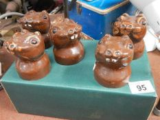 Five old garden rodent figures.