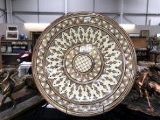 A large glazed terracotta bowl