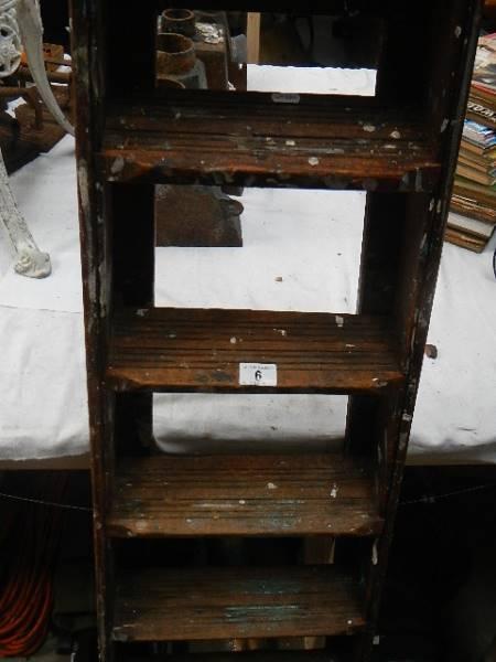 An old wooden step ladder.