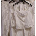 A collection of Victorian / Edwardian white clothing including camisole and bloomer one piece