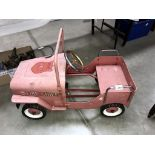 A vintage style Jeep Fire chief fire engine pedal car