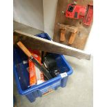 A box of tools and a drill sharpener.