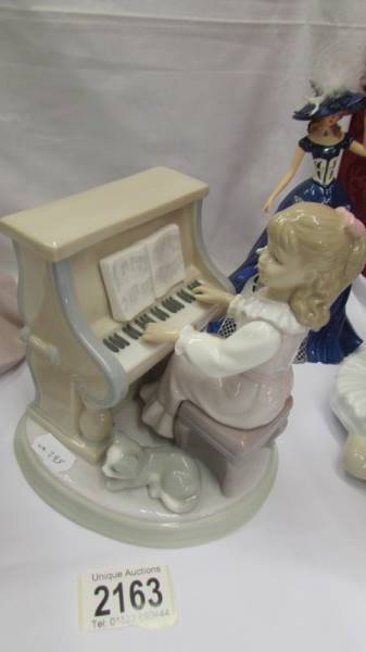 Three Lladro figures including girl at piano, - Image 5 of 6
