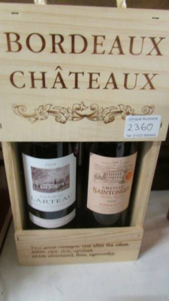 2 bottles of cased Chateau Bordeau wine.