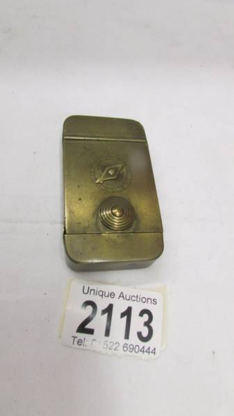 A 19th century brass snuff box with combination lock.