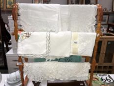 A quantity of 7 vintage tablecloths and 11 crocheted doilies
