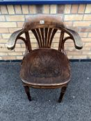 An early 1900's bentwood carver chair, carved detail to seat, turned legs, label to base.