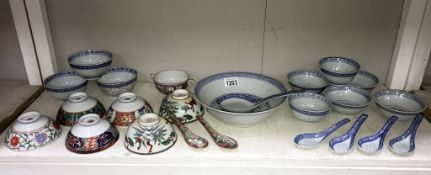 A quantity of Chinese rice dishes & spoons