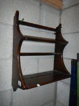 A small Ercol shelf unit, 42 x 28 x 21 cm.