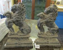 Two cast iron door stops modelled as rampant lions, circa 1900.