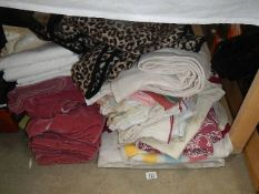 A quantity of bedspreads, curtains etc.