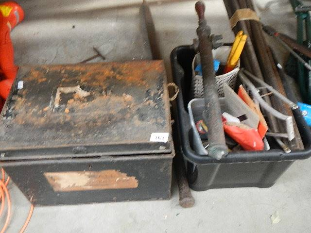 A tin box of tools and one other.