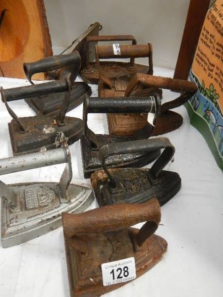 A quantity of old flat irons.