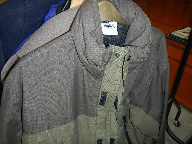 A rail of assorted suits, jackets and other clothing. - Image 4 of 11