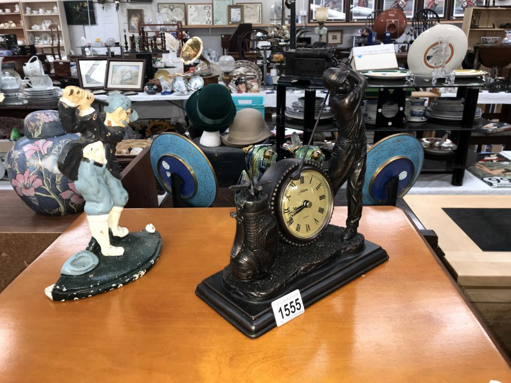 A cast iron door stop of a golfer and a Juliana collection clock figure of a golfer