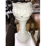 A white pottery jardiniere on stand (chips to top of stand)