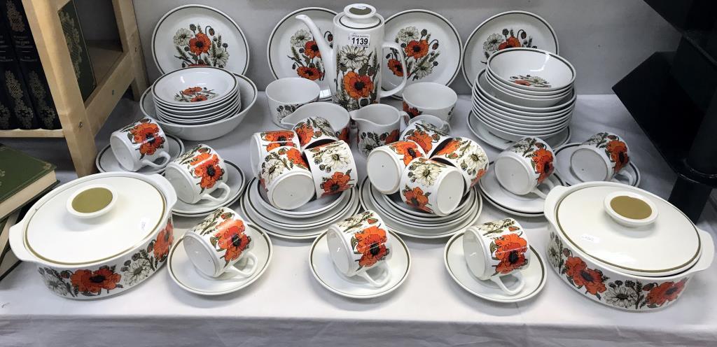A large lot of vintage J & G Meakin poppy pattern crockery,