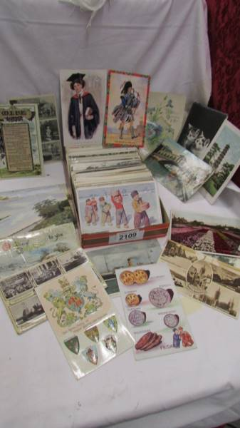 In excess of 200 interesting old postcards and greeting cards.