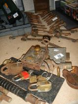 A mixed lot including stair carpet clips, padlocks etc.