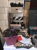 A quantity of handbags, purses,