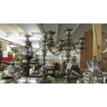 A pair of silver plate candelabra.