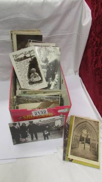 A box of old postcards.