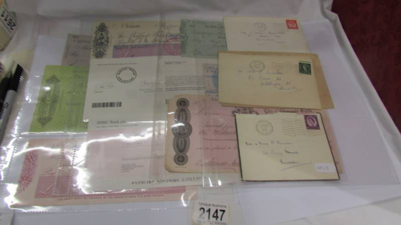 A collection of various bank cheques etc.