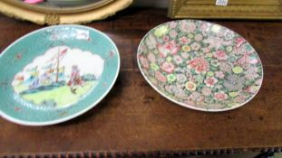 Two 32cm diameter Chinese plates, one floral and one with painted scene.