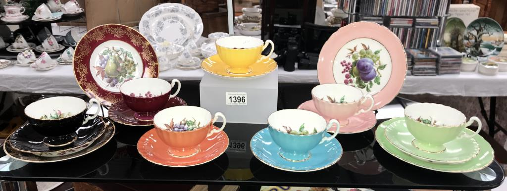 A quantity of Aynsley Trio's & cups & saucers (yellow saucer is Tuscan & green plate)