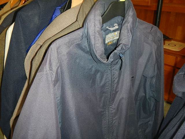 A rail of assorted suits, jackets and other clothing. - Image 3 of 11