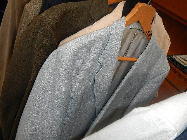 A rail of assorted suits, jackets and other clothing. - Image 7 of 11