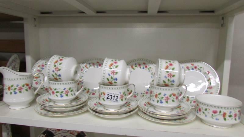 """A 20 piece Paragon """"Anastasia"""" pattern tea set."""