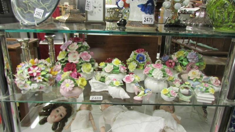 A collection of porcelain posies including Minton, Royal Doulton etc.