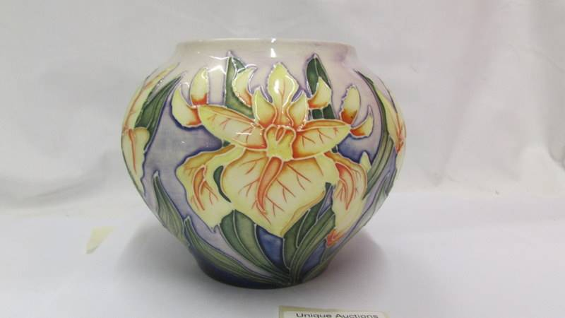 A Moorcroft small bulbous floral design vase (second). - Image 3 of 4