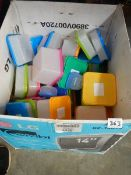 A quantity of coloured plastic topped containers.
