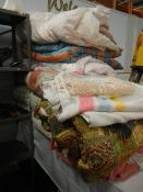 A large lot of bedding, quilts etc.