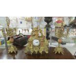 A French ormolu/brass clock garniture,