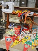 A large quantity of pennants, a sewing machine and sewing items etc.