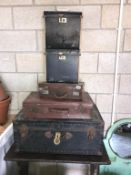 A selection of vintage suitcases, travel trunk, record cases,