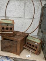 Two metal hoops, and old safe and two bird feeders.