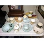 A quantity of vintage sandwich plates with cups