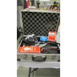 A Praktika camera, flash unit, lenses etc., in case.