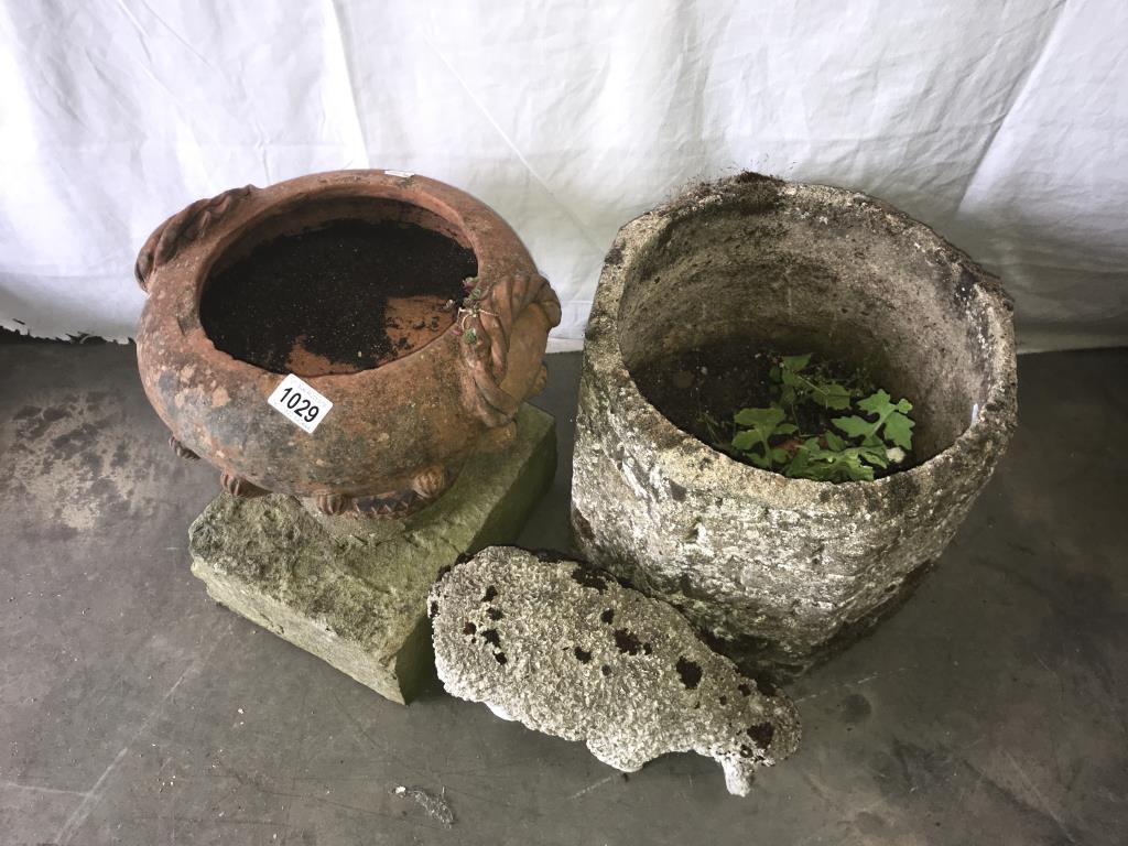 A terracotta urn,