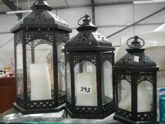 A set of three outside candle lanterns.