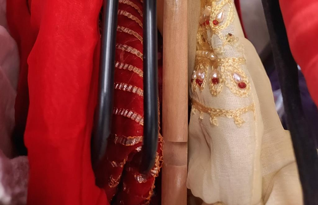Various outfits including a soft yellow Punjabi suit (tunic and draped trousers), - Image 2 of 2
