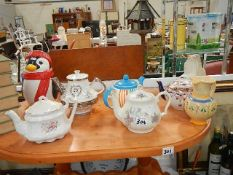 A collection of china tea pots in good condition.