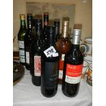 Eight unopened bottles of wine.